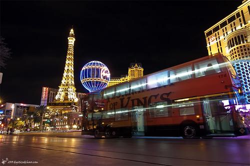 A double decker bus driving through the Strip in Las Vegas