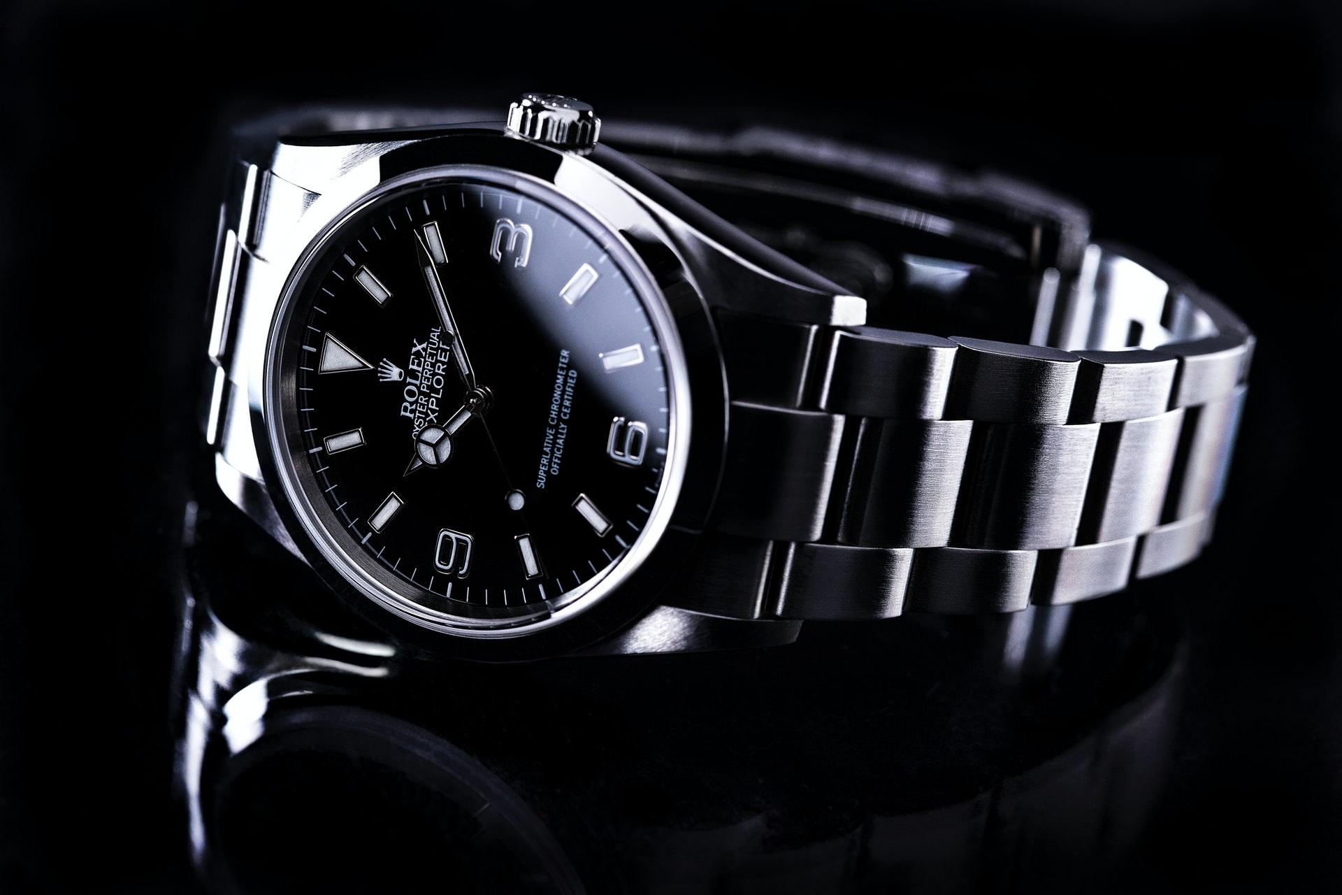 Siler Rolex watch on black background