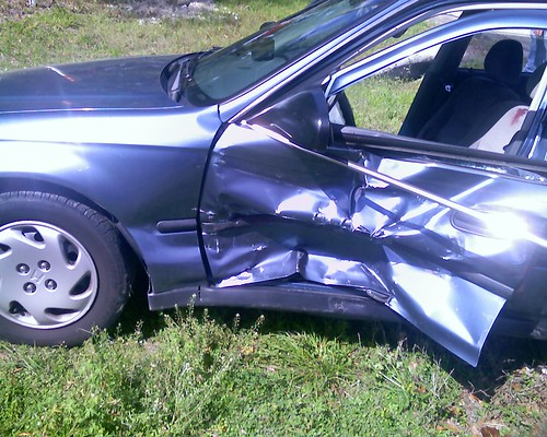 A blue car after an accident