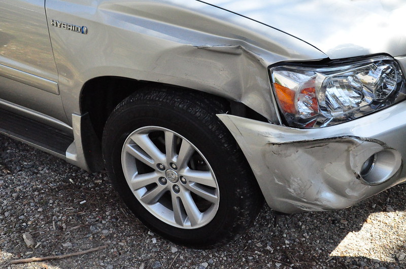 Dents in front right of silver hybrid car after car accident