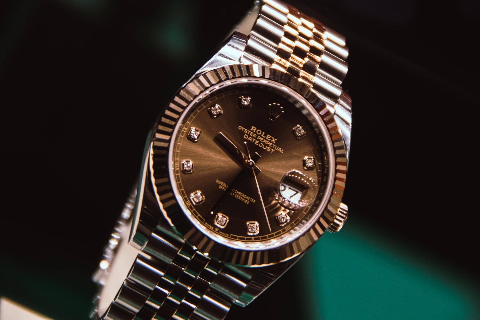 Copper Rolex Watch on black background
