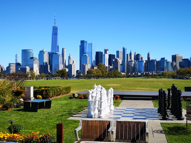 New Jersey Skyline over a park and a giant chess board