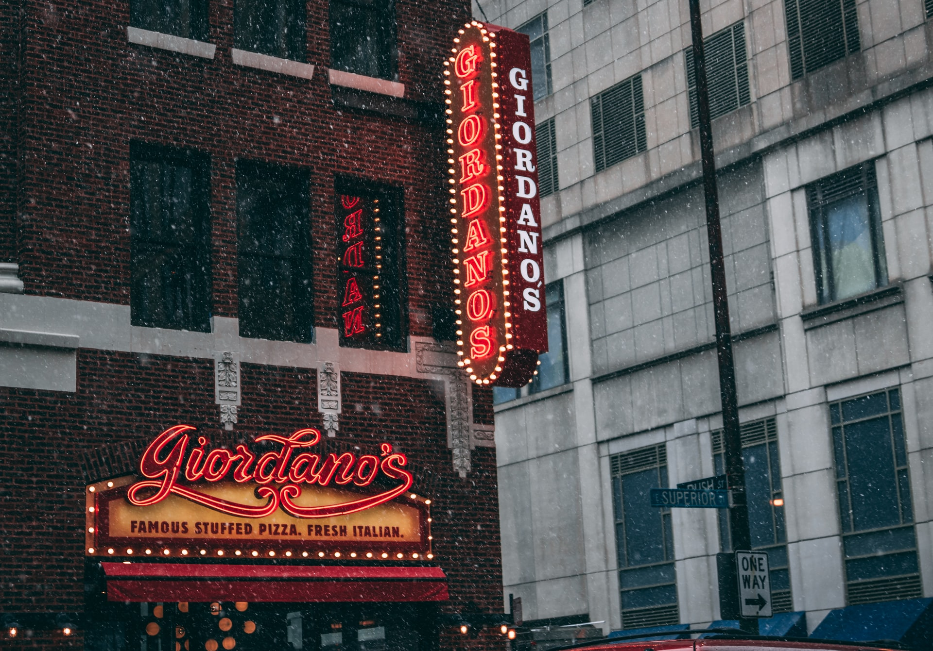 Lit up Giordano's signs at Giordano's restaurant on Superior and Rush in Chicago