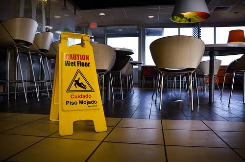 Wet floor sign in empty cafeteria