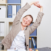 Quick stretches at your desk can help ease tension.